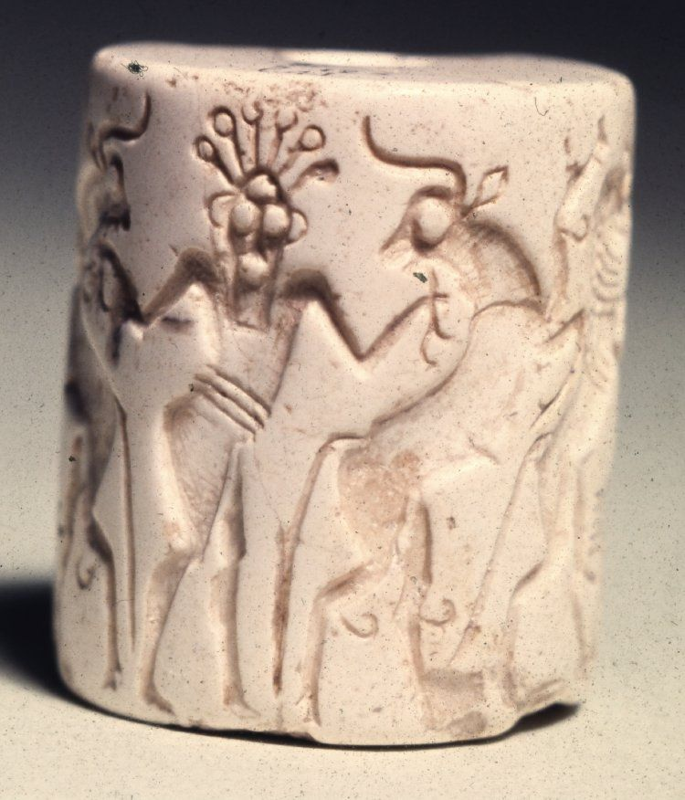 "2700 BCE Early Dynastic. Abu Habba, Sippar Iraq. Aragonite cylinder seal; contest scene; in the centre -  a bearded nude male with 6 roundels around his head termed a ""crested head-dress"", holds a bull in each hand."
