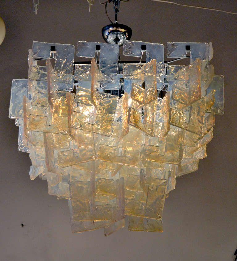 Incredible Interlocking Opalescent Glass Chandelier via http://www.1stdibs.com/furniture/lighting/chandeliers-pendant-lights/incredible-interlocking-opalescent-glass-chandelier/id-f_789369/