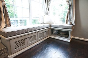 A Custom Built In Bench With Upholstered Cushion Is The