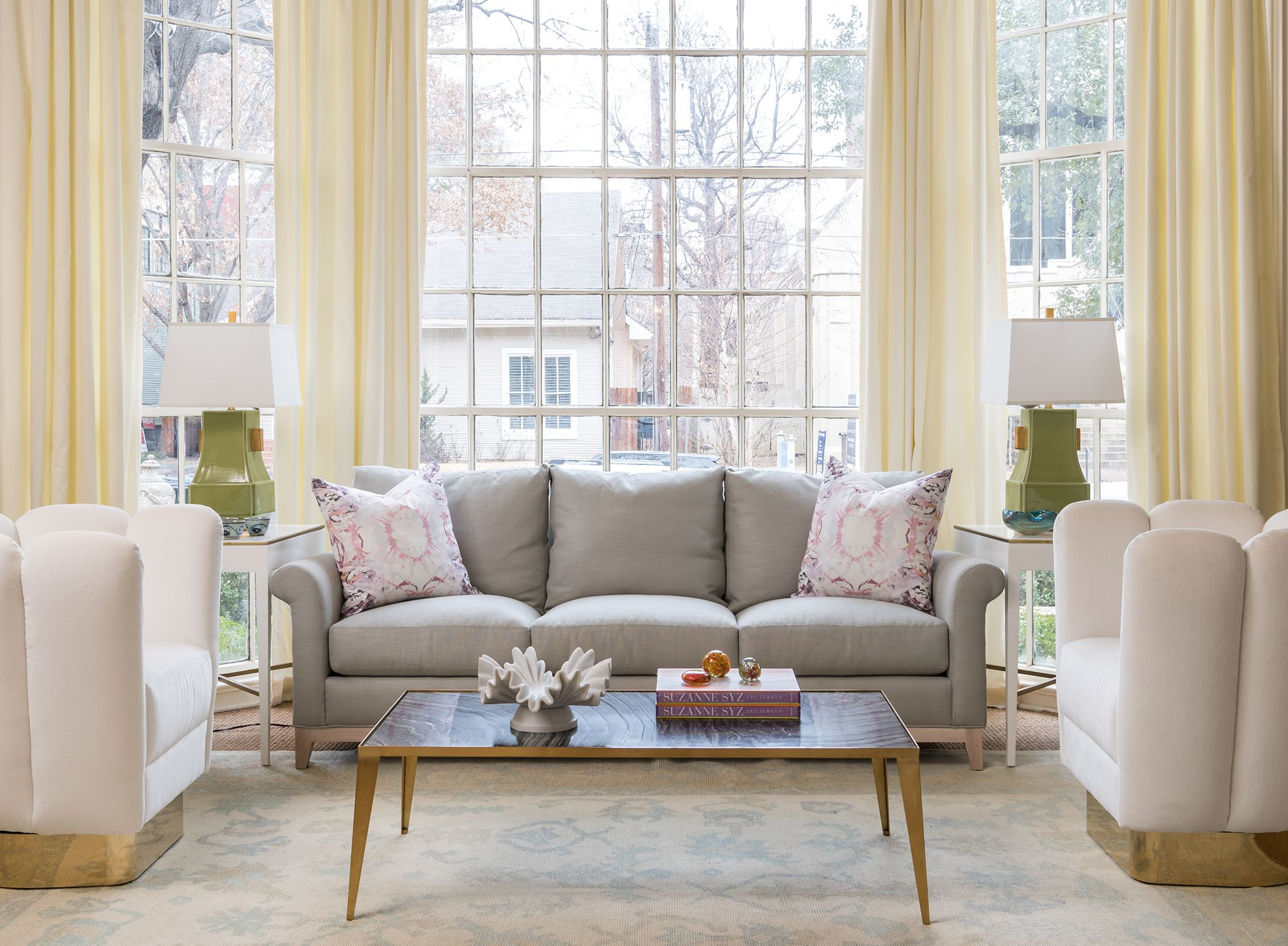 living room design with large windows | white and brass swivel ...