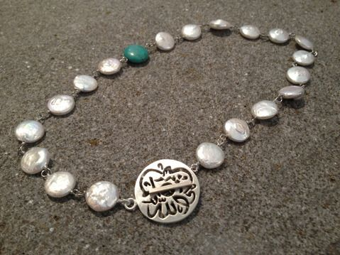 Forever a favorite- here is our classic necklace with freshwater pearls, and our signature turquoise stone