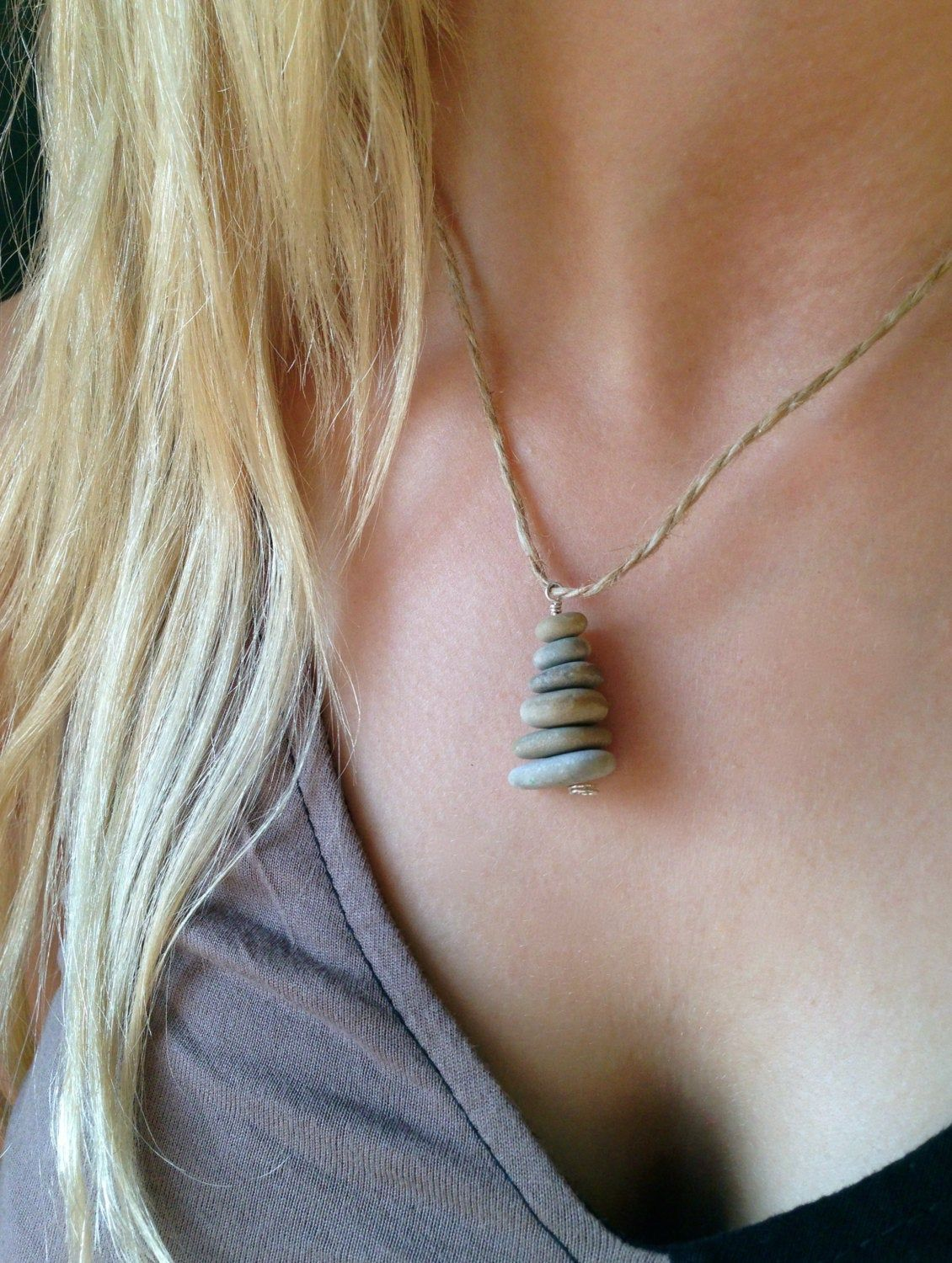 Photo of Zen beach stone pendant on long thin hemp chain both light and dark stone stacks