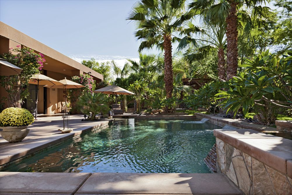 Tropical Backyard With Large Patio And Swimming Pool Small Fountains Lots Of Shade