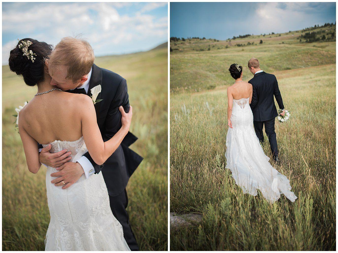 Bride in lace dress in colorado summer fields photo wedding