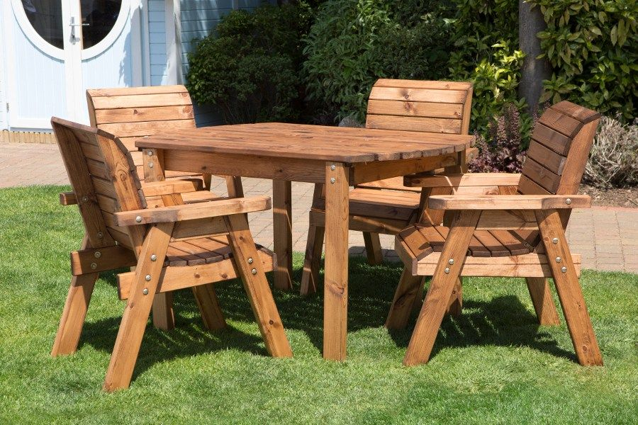 This Sustainable Outdoor Dining Table Set Consists Of A Table And Four Chairs Handcrafted In Wooden Garden Furniture Garden Furniture Sets Wooden Garden Table