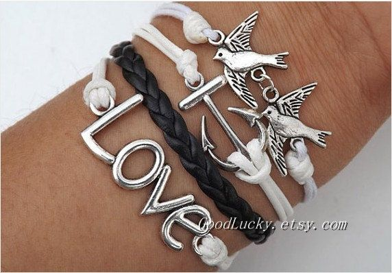Be kind to each other and love each other bracelet--silver anchor, bird and LOVE bracelet--white wax rope and black Leather braided bracelet. $9.99, via Etsy.