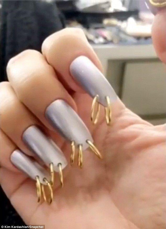 Kim Kardashian tries out pierced nails again with a silver chain ...