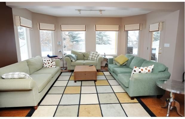In The Walkout Basement Large Windows Flood Room With Natural Light And Spotlight