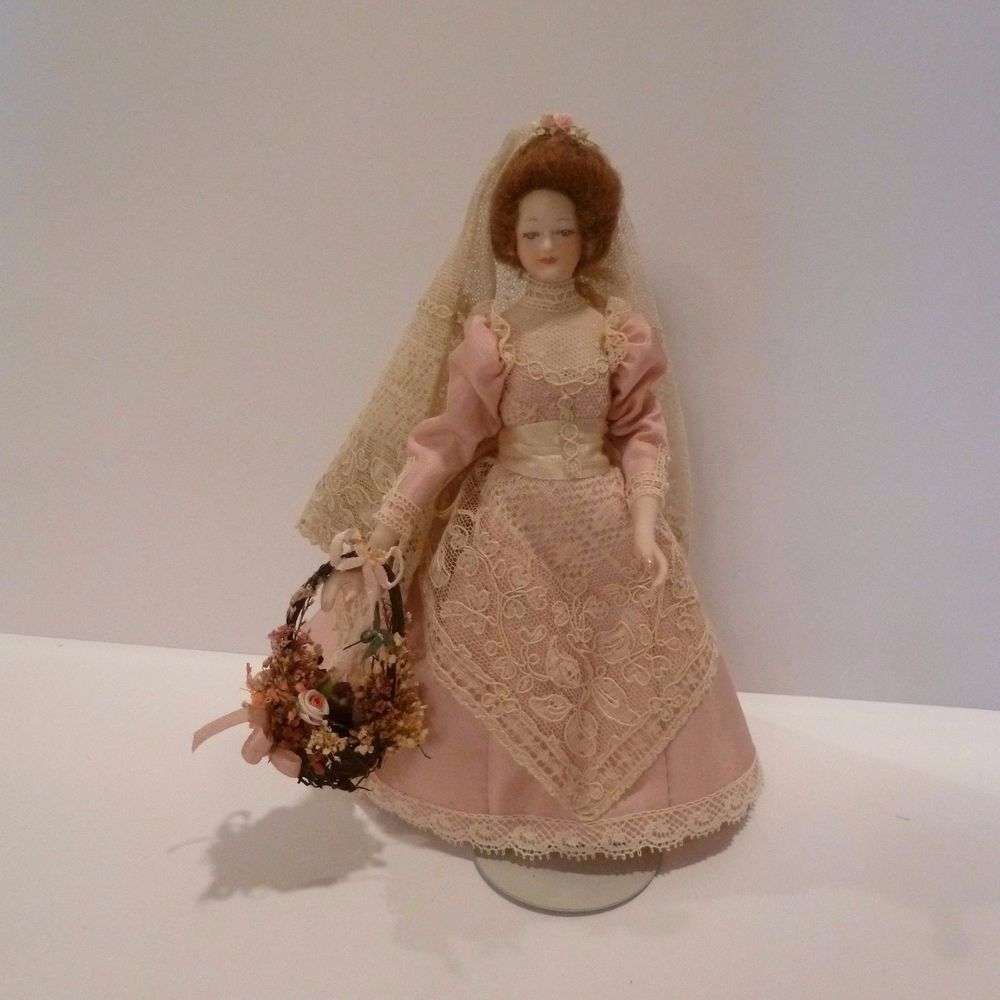 Rosemary Tucker, IGMA fellow - costuming of porcelain woman; basket by Karen M