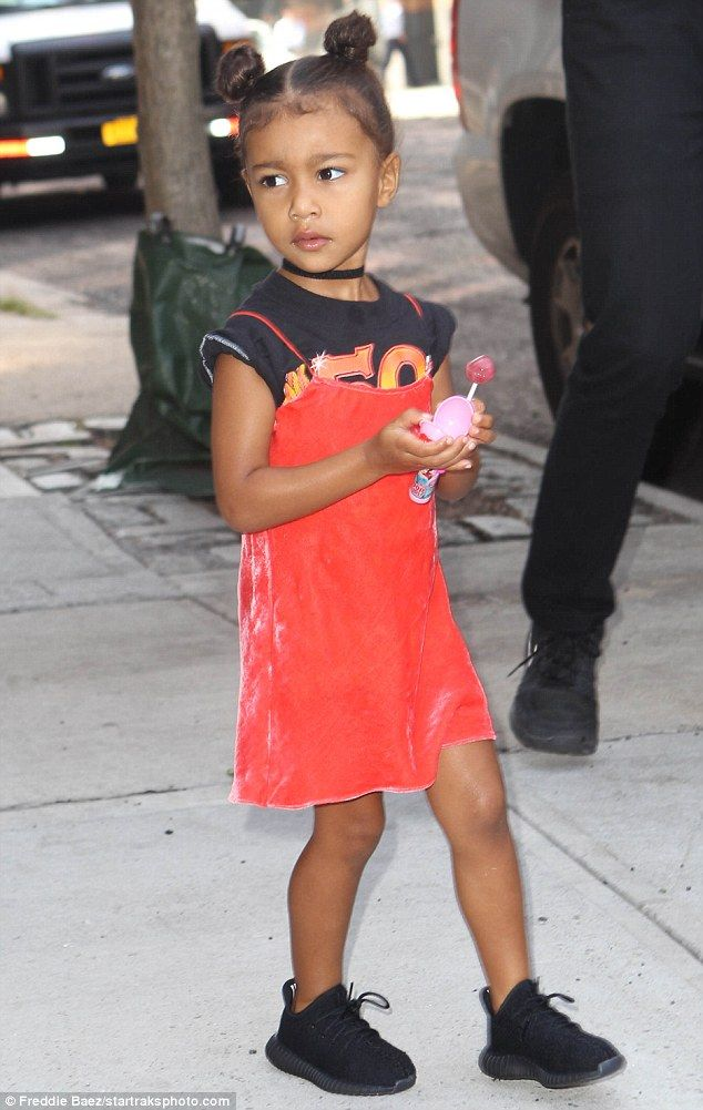 533209d616d Sugar for the little one  North West held onto a pink lollipop on Saturday  as she left the New York residence she has been staying at with mom and dad  this ...