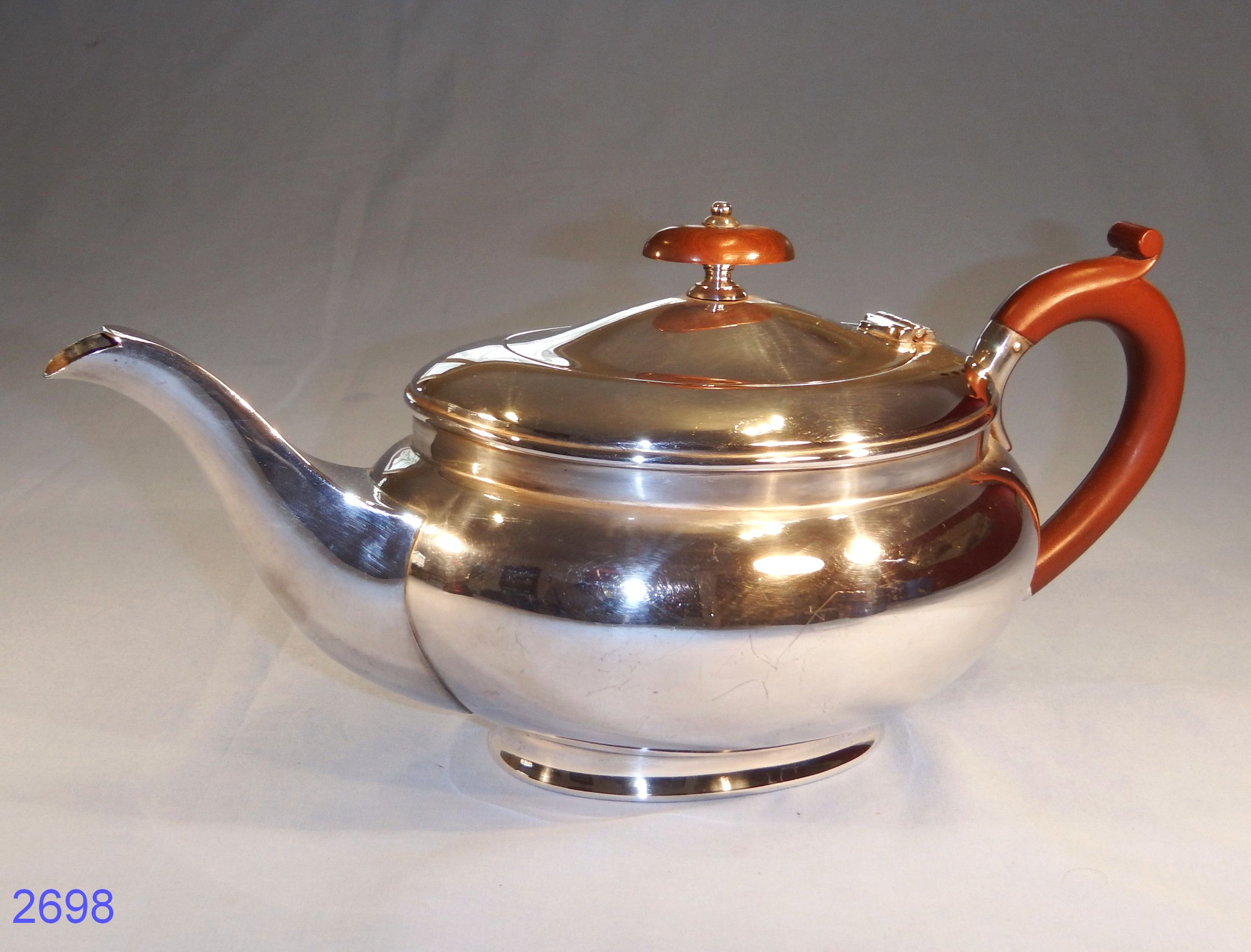 """Silver Plated Teapot made by J. H. Potter of Sheffield  Silver Plated Teapot made by J.H.Potter of Sheffield in the 1930s. Design no.1759. Engraved on the right hand side """"R.A. September 11th, 1937″."""