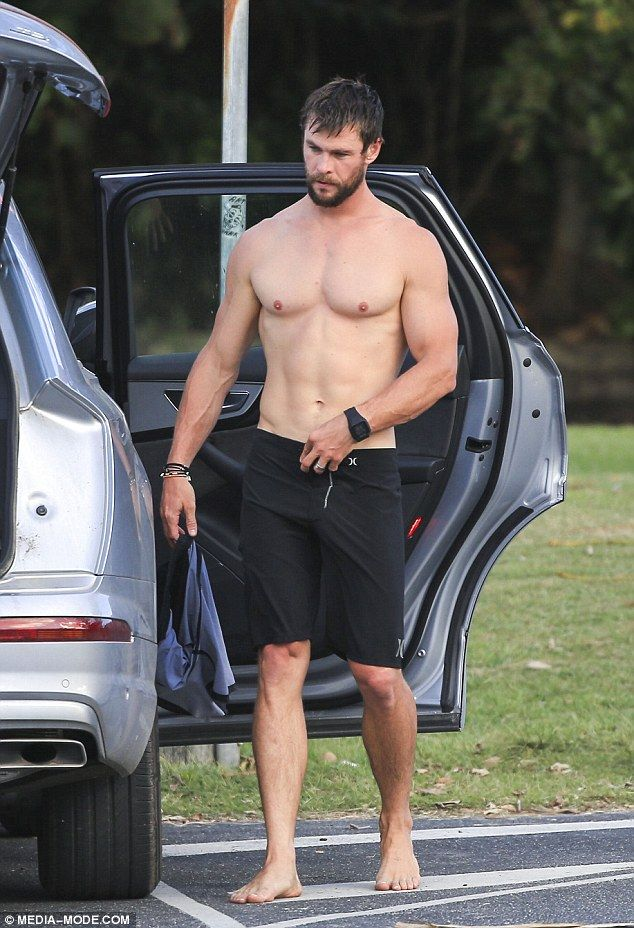 Chris Hemsworth shows off his buff body getting changed at ...