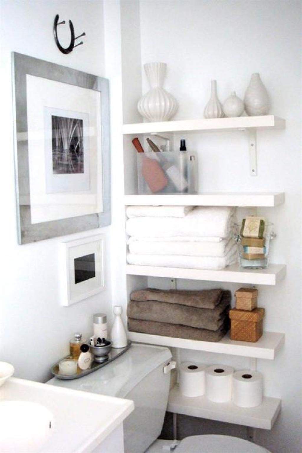 White Towel Shelved With White Interior Theme Design Also With ...