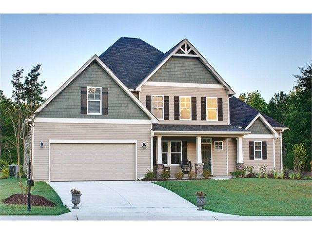 Craftsman Style Home With Green Shake Siding Accent And