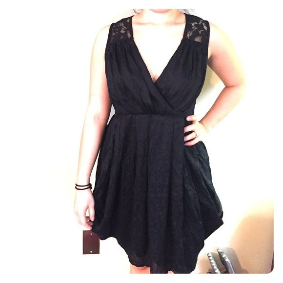 c857f3aa99f4 Little black dress Light and flowy black dress from H&M. Low cut with lace  back. Beautiful and sexy! Only worn a handful of times. In perfect  condition.