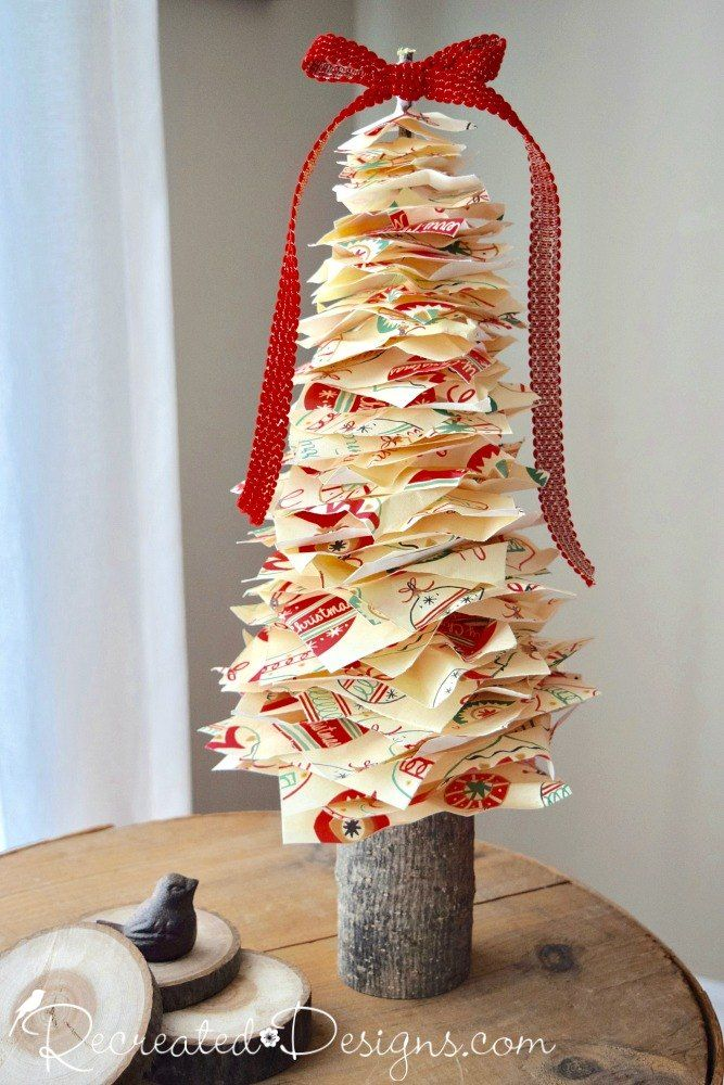 grab some christmas wrapping paper to make this adorable tree for your mantel