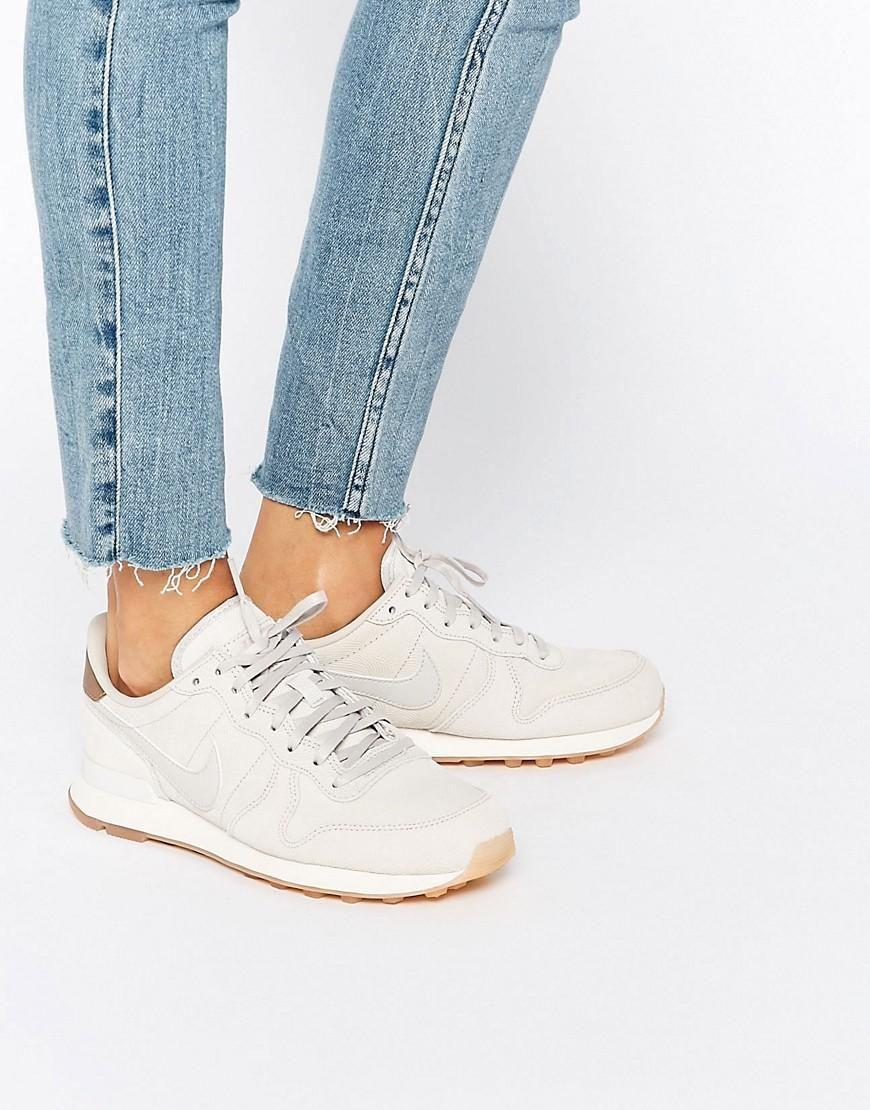 Nike | Nike White & Gold Internationalist Premium Sneakers at ASOS