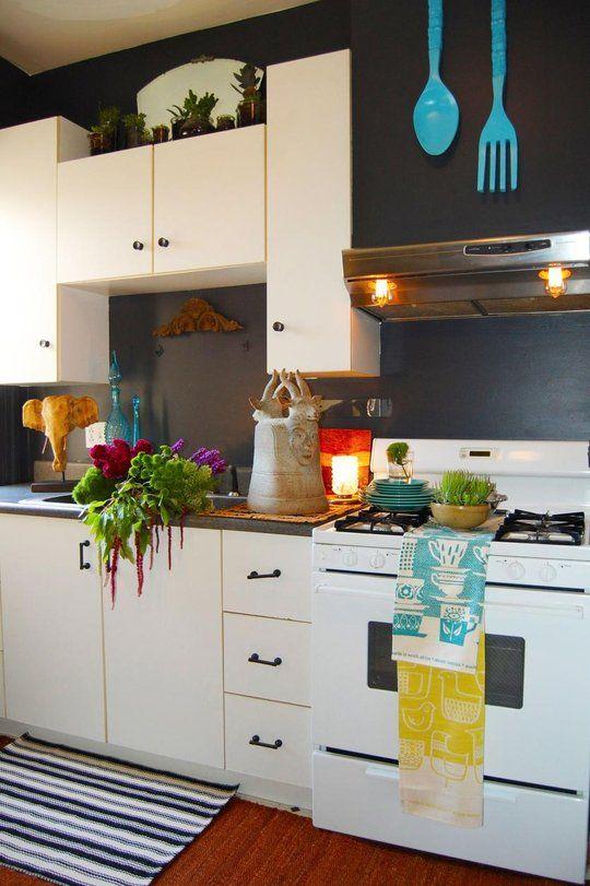mirror & mini plants above cabinets. NO dusty fake plastic ...