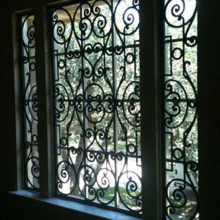 Tableaux Faux Iron in a foyer window from Shutter-Up