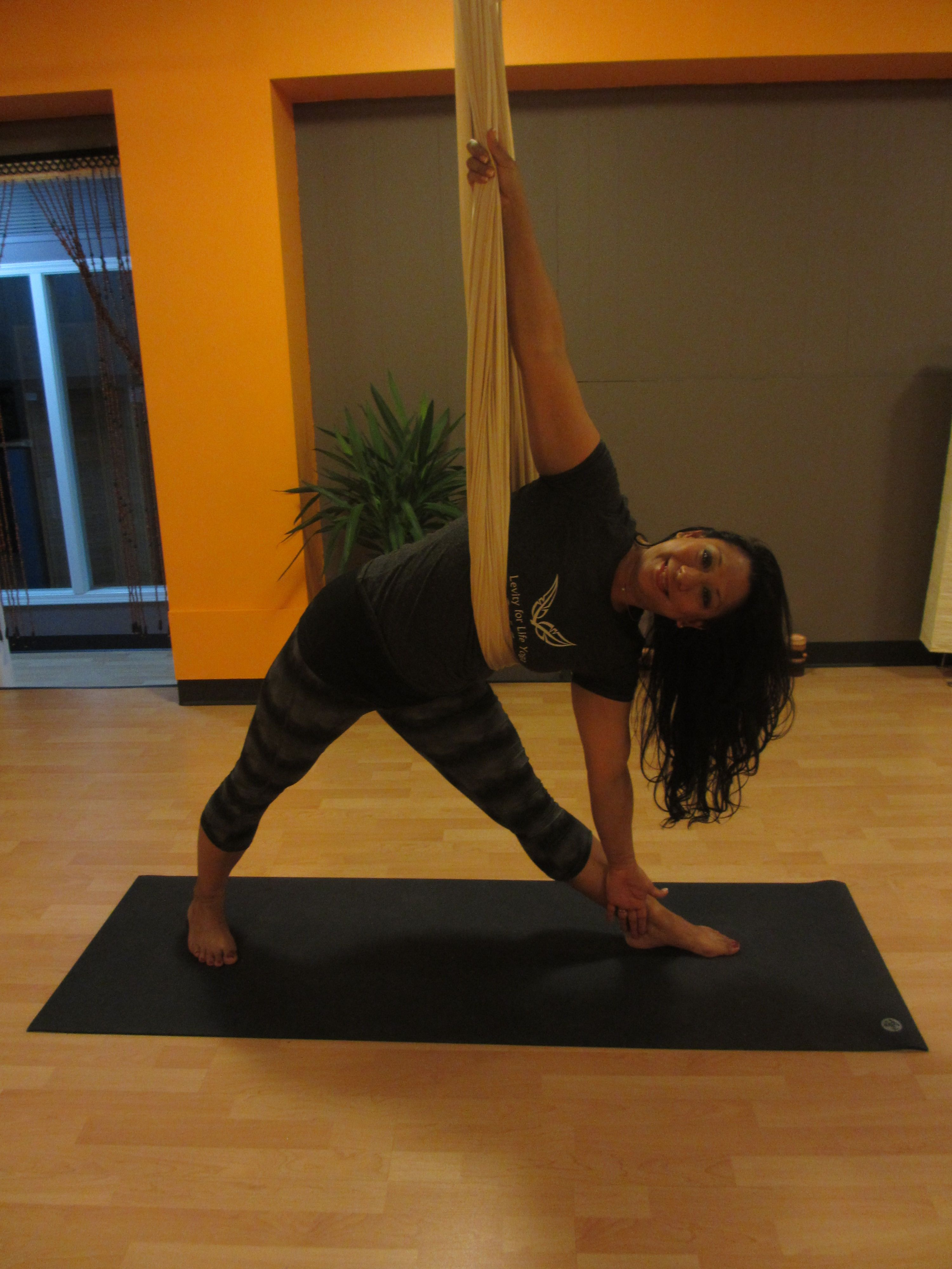 Did You Know That Triangle Pose Engages Every Part Of Your Body Try Aerial Yoga To Stretch And Strengthen Your Aerial Yoga Poses Aerial Yoga Free Yoga Videos