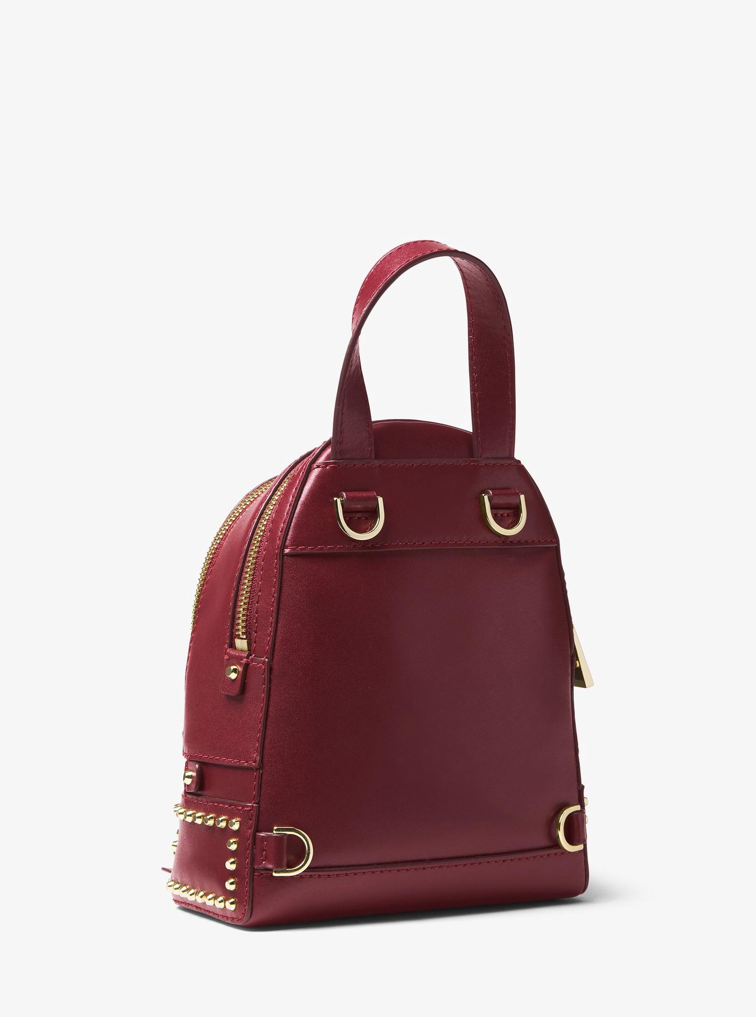 c4f299b04a76 Michael Kors Rhea Mini Studded Leather Backpack - Oxblood | Products ...