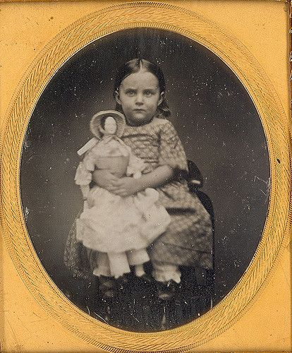 1/6 plate daguerreotype of little girl Id'ed as Ida M. Babcock on back of image. Nice example of an early 1850's doll with cute bonnet.