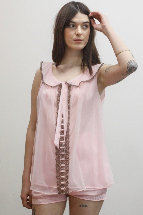 0e56f8f2d73 Super cute babydoll nightie set including a sheer light pink double layer  top and matching sheer short bloomers. Top is in a trapeze shape
