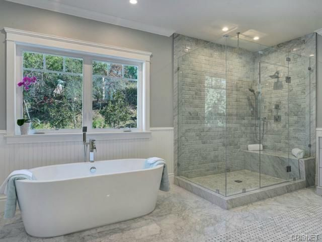 Master Bathroom Gray beautiful master bathroom with drop-in tub, white tile, stone tile