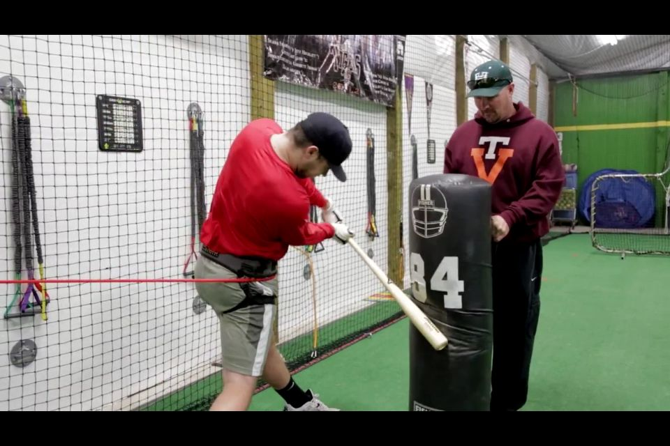 Pro Baseball Player Training Hitting Power And Bat Speed In Off Season Resistance Band Resists Hip Turn Forcing Back S Pro Baseball Bat Speed Baseball Players