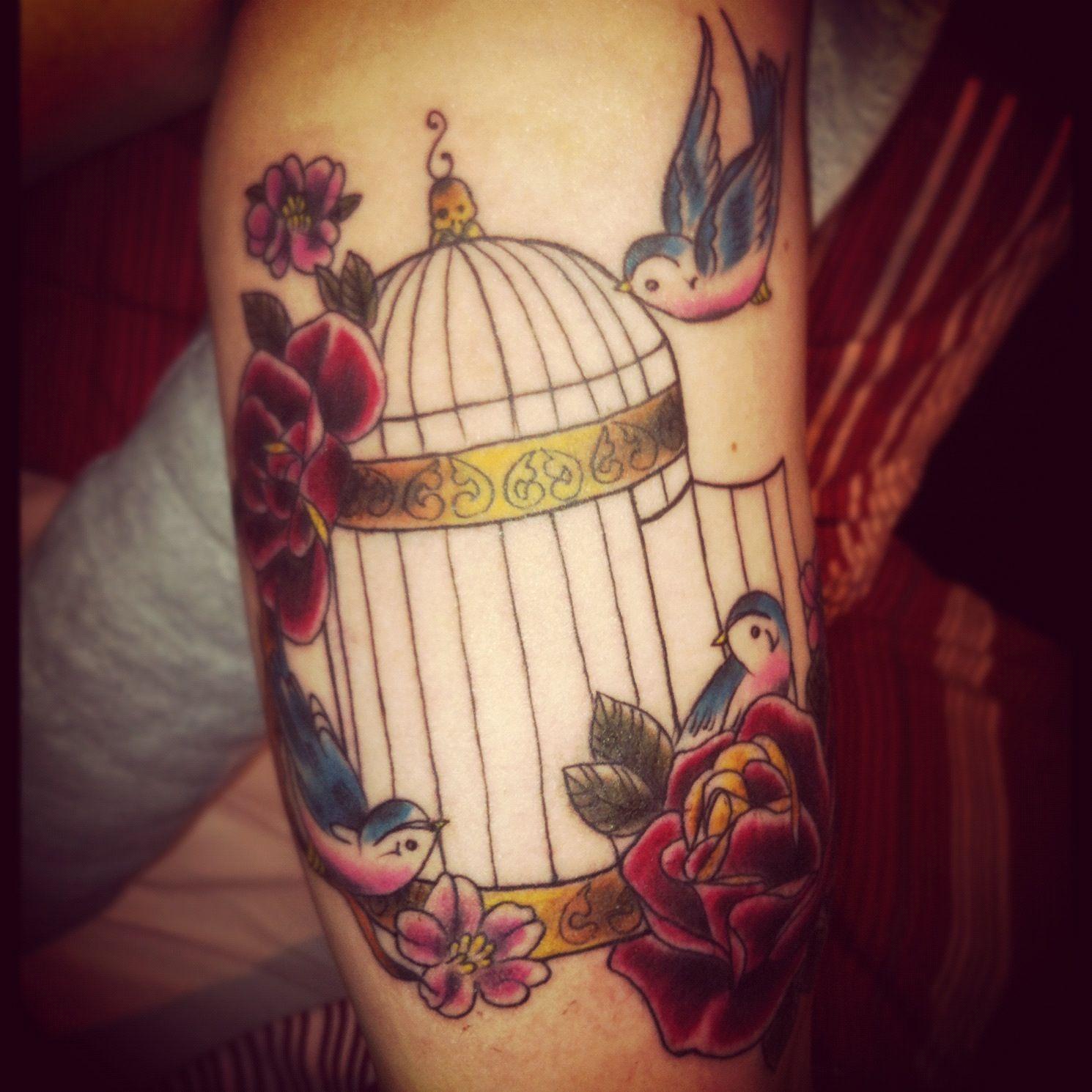 Birdcage Under Bicep Tattoo