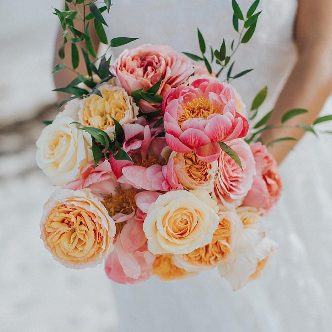The bride carried a lush bouquet with gigantic blooms at her bahamas the bride carried a lush bouquet with gigantic blooms at her bahamas beach wedding izmirmasajfo