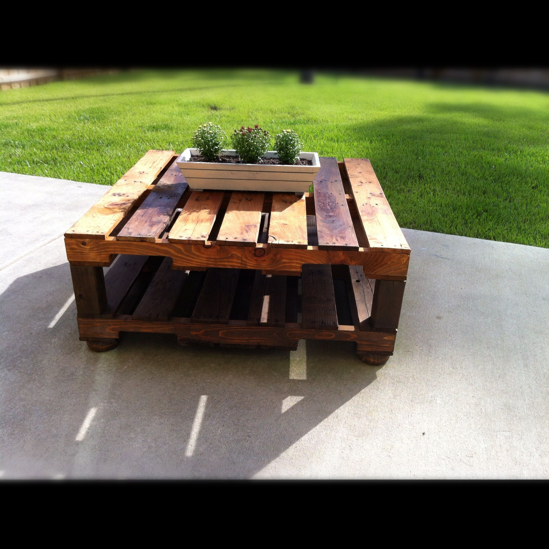 Outdoor table made with 2 free pallets 4x4 wood legs from Lowe s
