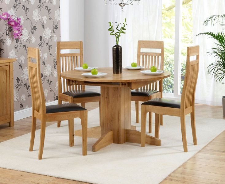 depiction of round dining table set for 4 | perfect dining room