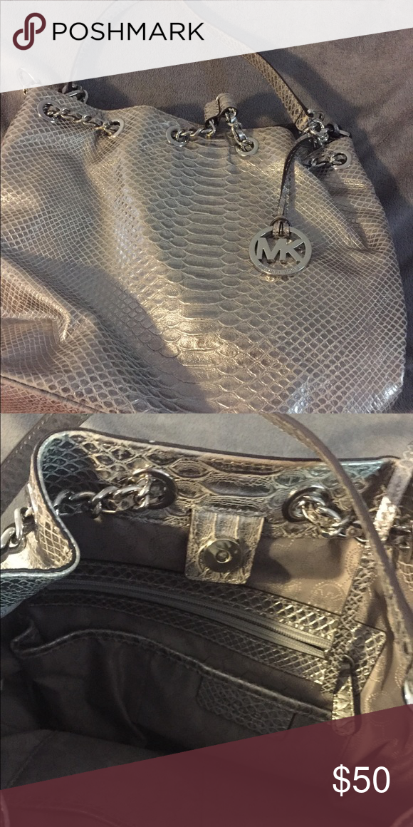 a1e3aad9abac Michael kors Silver snakeskin bucket bag I used maybe five times I then got  a new bag for Christmas so this has been sitting in my closet Silver chain  and ...