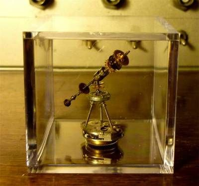 "Amazing!  altered arts steampunk telescope created totally from watch parts (some of them antique) in clear acrylic box, 2"" square.  by Las Vegas artist Pierre Molangi.  sold on ebay by bellykatstudio $19.95"