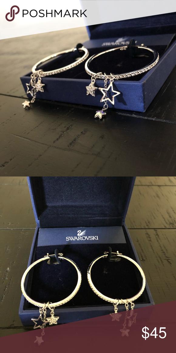 02932c415fa36f Swarovski Crystal Hoops with Dangling Stars Never worn Swarovski earrings. Swarovski  Jewelry Earrings