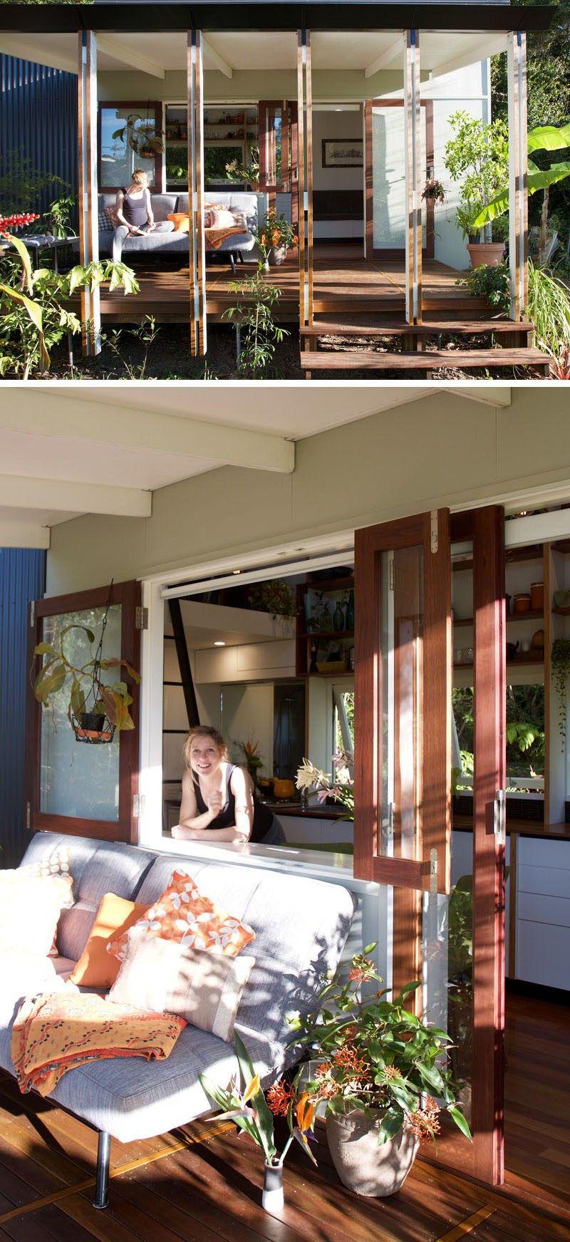 Dieses benutzerdefinierte gestaltete kleine Haus hat eine kleine ...