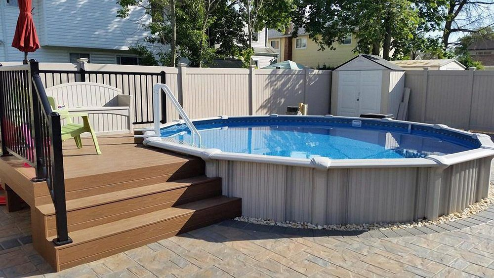 semi in ground pool with deck