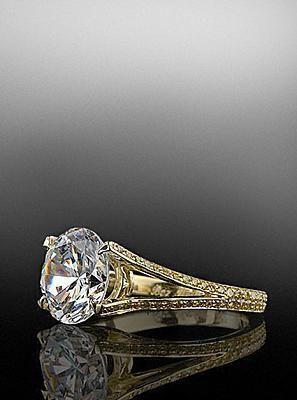 Round brilliant center diamond with yellow diamond pave mounting. By Bez Ambar.