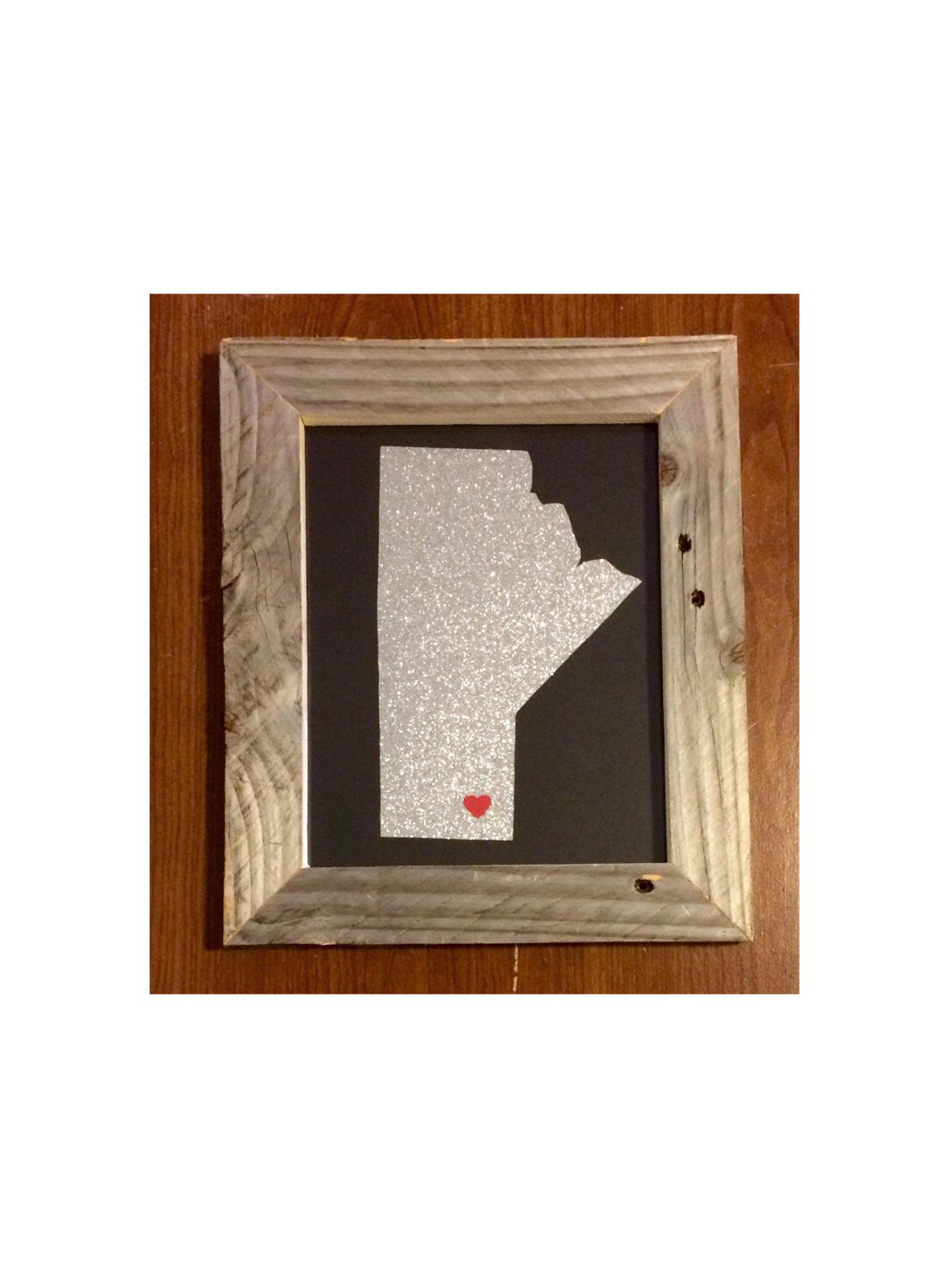 A personal favorite from my Etsy shop https://www.etsy.com/listing/236163081/manitoba-hometown-pride-driftwood-frame
