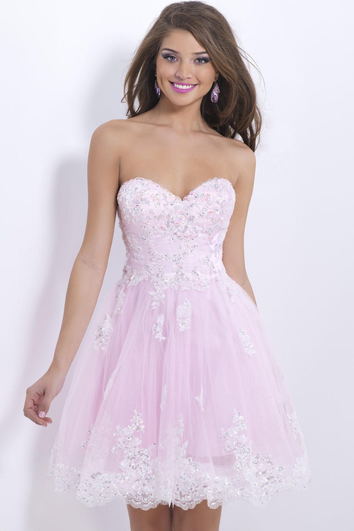Pastel jewels and delicate lace create a stunning dance gown. A ...