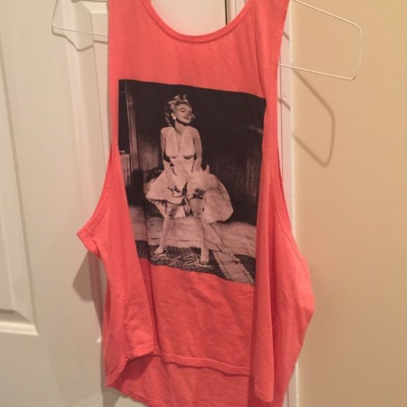 cut off This cut off is a coral color with a black and white picture of Marilyn Monroe. Perfect for working out in. Marilyn Monroe  Tops