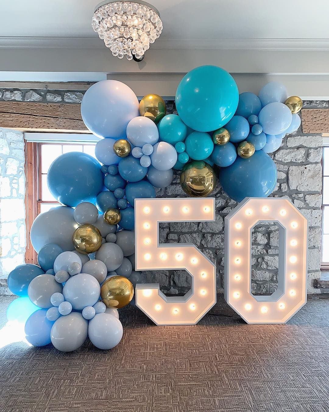 "Balloons By Dina on Instagram: ""Beautiful hues of blue for this stylish 50th birthday.  Balloons by us @balloonsbydina  Lightup Numbers by @marqueeletterstoronto"" #moms50thbirthday"