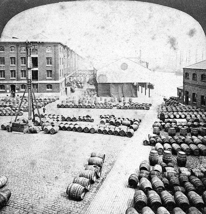 North Quay, London Dock, Wapping, with cargo, mostly barrels, laid out in front of the warehouses.