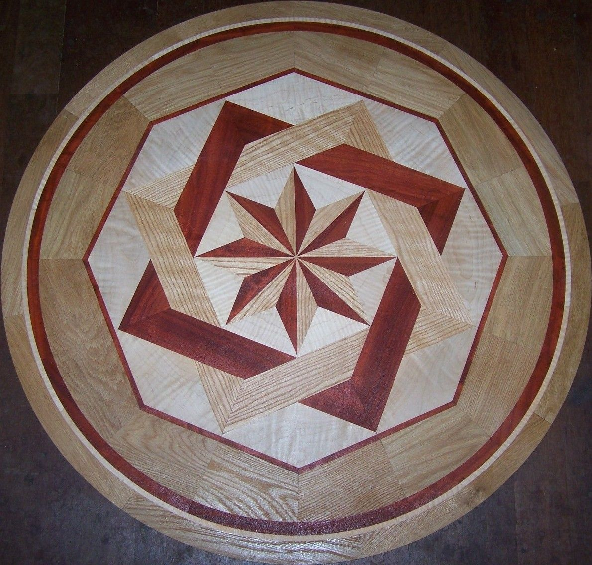 Hardwood floor medallion inlays and compass roses things for Wood floor medallion designs