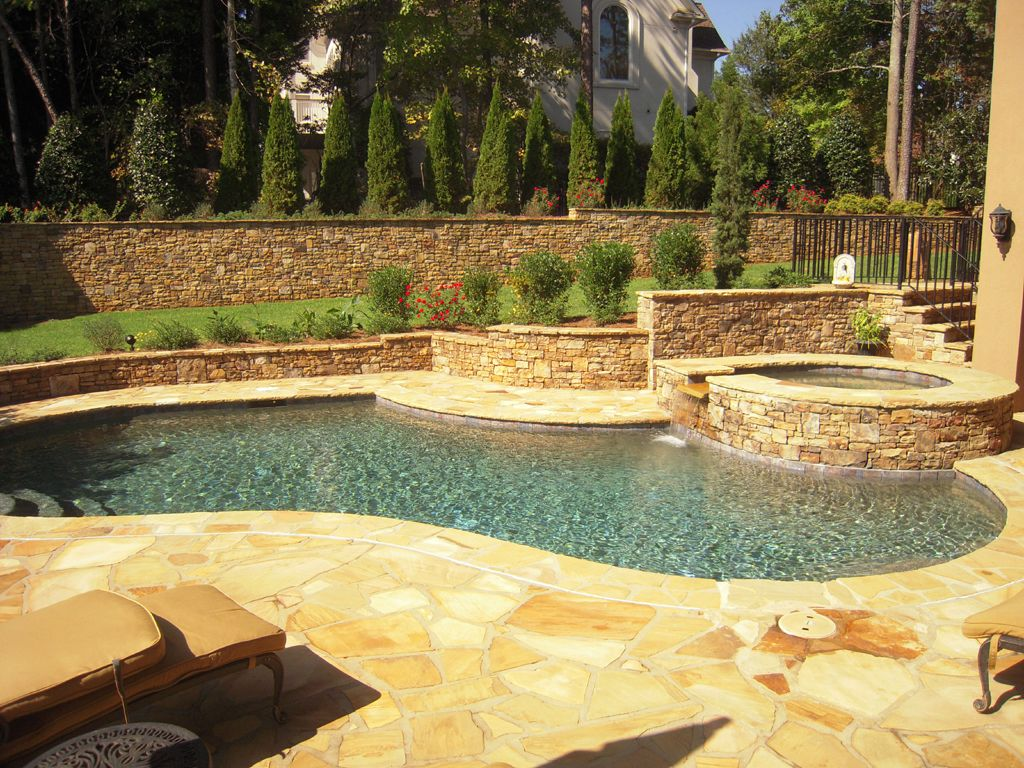 Stacked stone wall, jacuzzi. Flagstone pool deck. | Courtland Pool ...