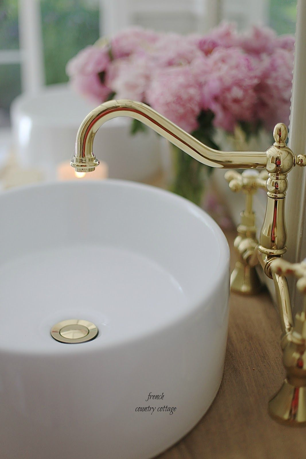 brass faucet in french cottage bathroom Elegant