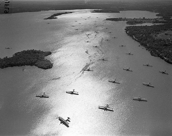 Nearly 30 PBY Catalina flying boats at anchor 1940s in an unknown location