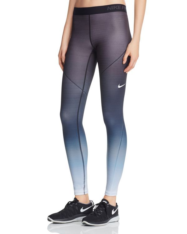 On your mark, get set, glow. Nike's striking ombre-fade leggings keep you cozy for cold-weather workouts with the label's Hyperwarm technology. | Polyester/spandex; lining: polyester | Machine wash |