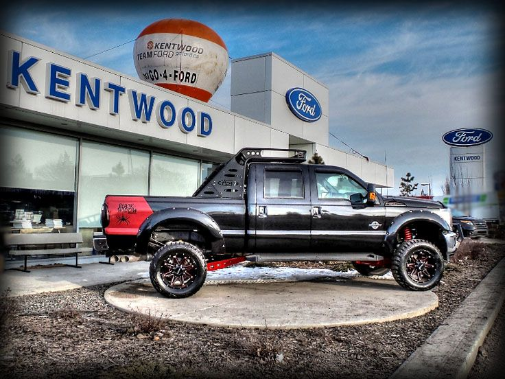 """SOLD!!  Lifted 2014 #FORD  #F350 Lariat """"Black Widow"""" edition #SuperDuty #PickUp #truck.   Contact us for more info or to purchase.  - Modifications include:   - 6"""" ProComp Lift & 20"""" DPR Wheels & MT2 Tires   - Painted Flares   - Power coated suspension parts   - Custom Sprayliner in red  - Ventshades   - Bug Deflector   - Spyder bull bar and light  - Black window decals   - Box tire rack and light   - Lighted F-350 name plates   - Tinted windows and T/L"""